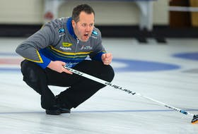 Skip Jamie Murphy throws his rock during the Deloitte Tankard men's curling final against Kendal Thompson  at the Dartmouth Curling Club on Sunday. Ryan Taplin - The Chronicle Herald
