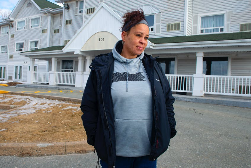 Rebecca Sparks poses for a photo in front of the Travelodge Suites in Dartmouth on Saturday. Sparks, and several other people who have been staying at the hotel through an arrangement with the community services department, are scrambling to find a place to live after they were told on Thursday they had 24 hours to move out. Ryan Taplin - The Chronicle Herald