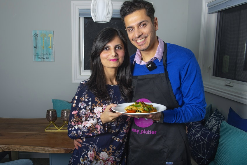 Poleen Kaur and her husband Mandhir Singh pose for a photo at their Halifax home on Tuesday, March 2, 2021. Singh's business, Easy Platter, connects customers with local personal chefs.