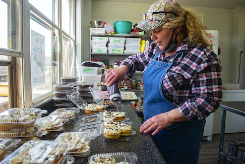 Daphne O'Neil drizzles chocolate on some donuts at The Ketobolic Kitchen in Bridgetown on Wednesday, March 24, 2021. O'Neil, and her husband Robert, started the bakery in 2018 after moving from Ontario.