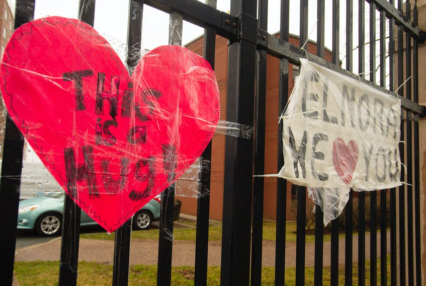 Homemade signs of support and affection are taped to a metal fence across from the Northwood Manor on Gottingen Street in north-end Halifax.