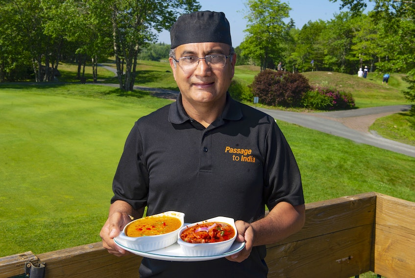 Passage to India owner Sunny Sethi holds a plate with vegetable korma and butter chicken, two items on the menu at his new location at the Granite Springs Golf Club in Bayside.