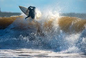 A surfer competes at the Surfing Association of Nova Scotia's Fall Classic short-board contest at Lawrencetown Beach on the weekend. Surfers from Quebec have been accused of travelling to Nova Scotia's beaches and not self-isolating.