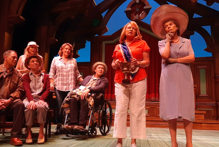 """Neptune Theatre's production of Calendar Girls tells the true story — turned into the 2003 feature film — about a group of Yorkshire Women's Institute members who raise money for a cancer ward by posing for an """"alternative"""" calendar that becomes a national sensation. Left to right: Burgandy Code, Jim Fowler, Francine Deschepper, Marlane O'Brien, Shelley Thompson, Daniel Lillford, Martha Irving, Mauralea Austin"""
