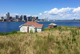 The Halifax Waterfront rises in the background of the historic Lighthouse Keeper's house on George's Island. The historically rich island will be open to the public on weekends starting Saturday, Aug. 8, 2020.