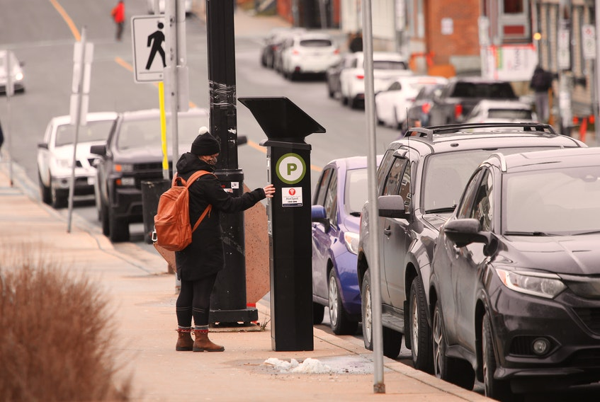 FOR NEWS STORY: A woman uses a parking kiosk on Queen Street Halifax Wednesday January 6, 2020..   TIM KROCHAK PHOTO