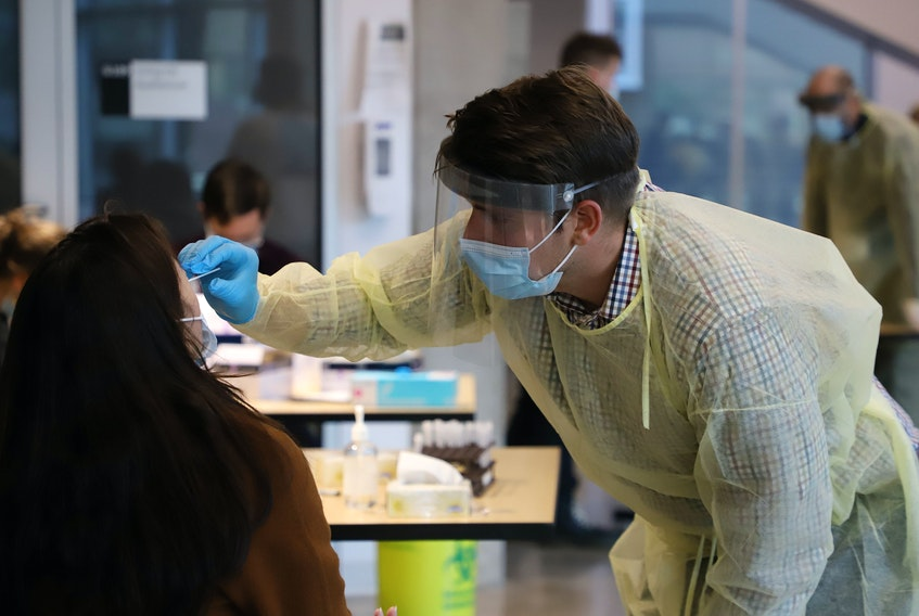 FOR NEWS STORY: A student undergoes a swab test, during free pop up COVID-19 testing site in the Ricard Murray Design Building in Halifax Tuesday November 24, 2020. Hundreds of students lined up for the rapid tests. TIM KROCHAK PHOTO
