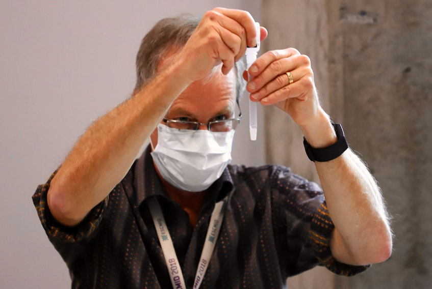 FOR NEWS STORY: A medical technician prepares a rapid COVID-19 test sample, at a pop-up testing site in the Richard Murray Design Building in Halifax Tuesday November 24, 2020. Hundreds of students lined up for rapid testing. TIM KROCHAK PHOTO