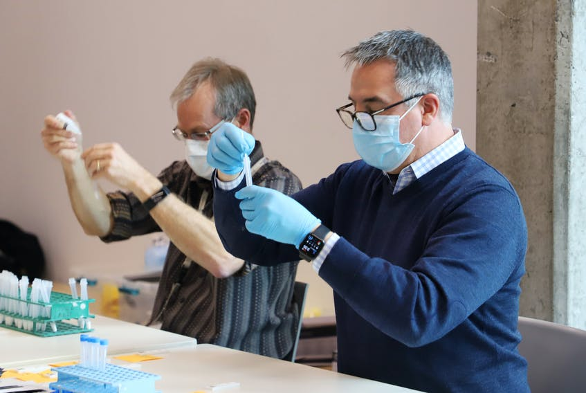 FOR NEWS STORY: Technicians prepare rapid COVID-19 test samples, at a pop-up testing site in the Richard Murray Design Building in Halifax Tuesday November 24, 2020. Hundreds of students lined up for rapid testing. TIM KROCHAK PHOTO