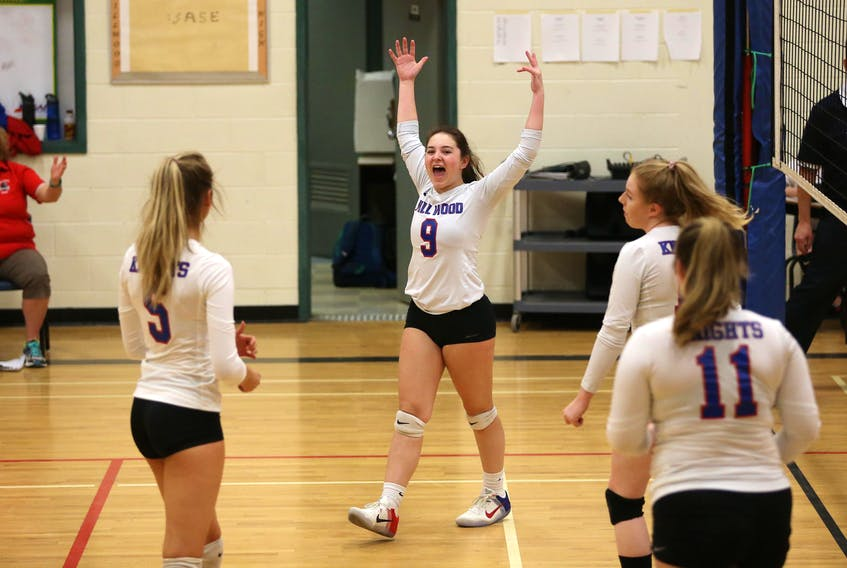 Millwood Knight's Makayla Drysdale (9) reacts after a big kill in the opening set against the   Auburn Drive Eagles in metro high school girls' volleyball action in Lower Sackville on Wednesday. Looking on are Olivia Day (5), Angelina Bevis and Kylie Simpson (11). The Knights won the match 3-2. Tim Krochak / The Chronicle Herald