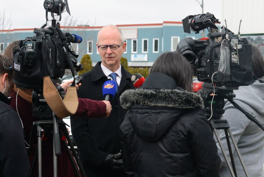 Progressive Conservative Leader Ches Crosbie speaks to reporters Friday outside his campaign headquarters on Austin Street in St. John's.