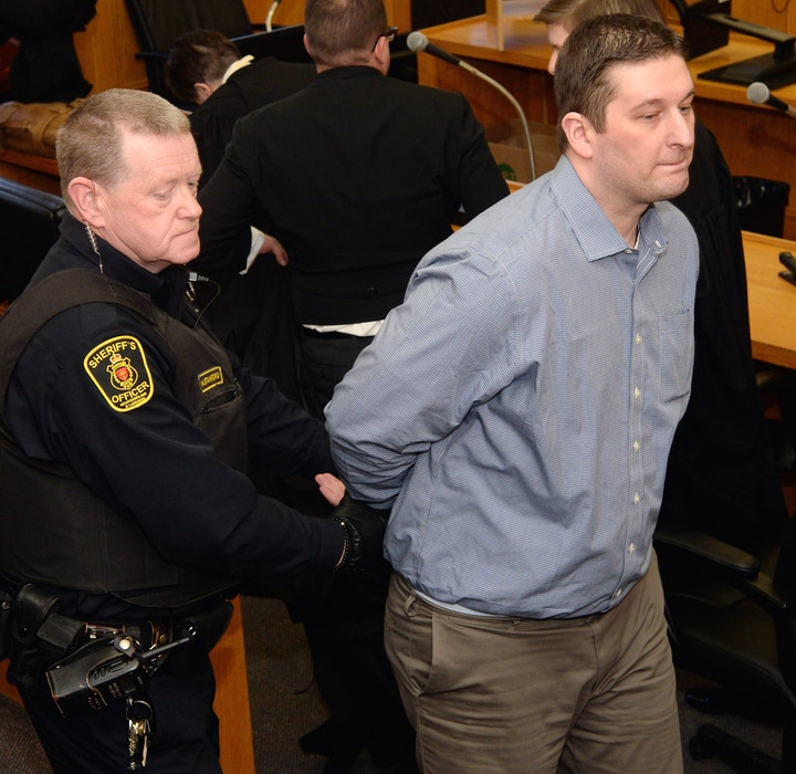 Trent Butt is taken out of the courtroom by sheriff's officers after the jury found him guilty of first-degree murder of his five-year-old daughter. - Joe Gibbons