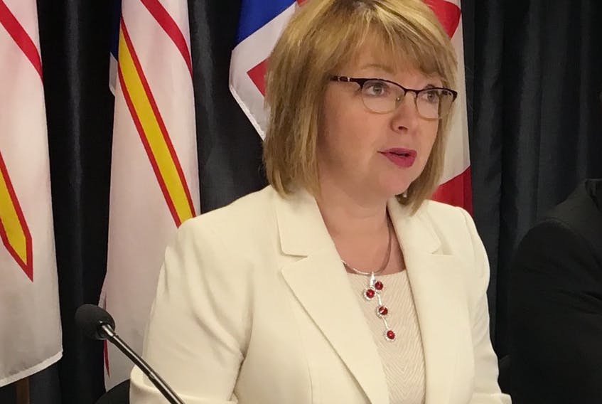 Children, Seniors and Social Development Minister Lisa Dempster speaks Tuesday about changes in legislation aimed at improving conditions for youth in government care.