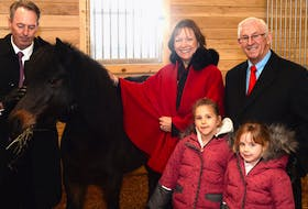 From left, Capital Campaign chairman Paul Antle, Patricia Fagan, Lt.-Gov. Frank Fagan and Antle's daughters, Soleil, 5 and Cleo, 4, pose with Pickles, one of the horses at the new Rainbow Riders centre. Patricia Fagan is honorary patron of Rainbow Riders.