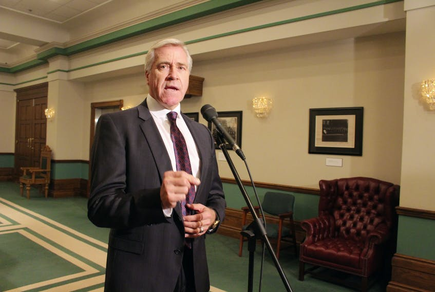 Premier Dwight Ball speaks to the media Monday afternoon outside the House of Assembly. Ball said the government is willing to change legislation to force Nalcor Energy to be more transparent.