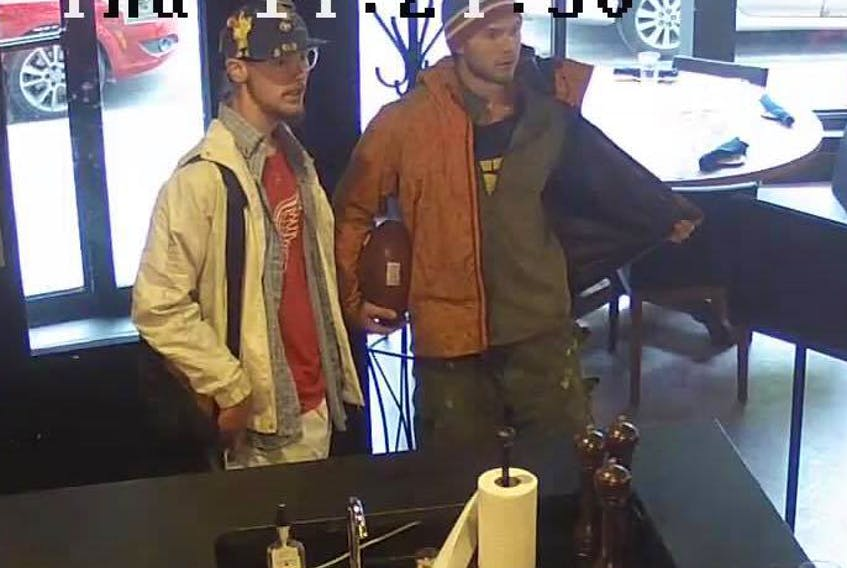 Benjamin (left) and Francois Boucher are shown in surveillance video from the Fifth Ticket restaurant in St. John's.