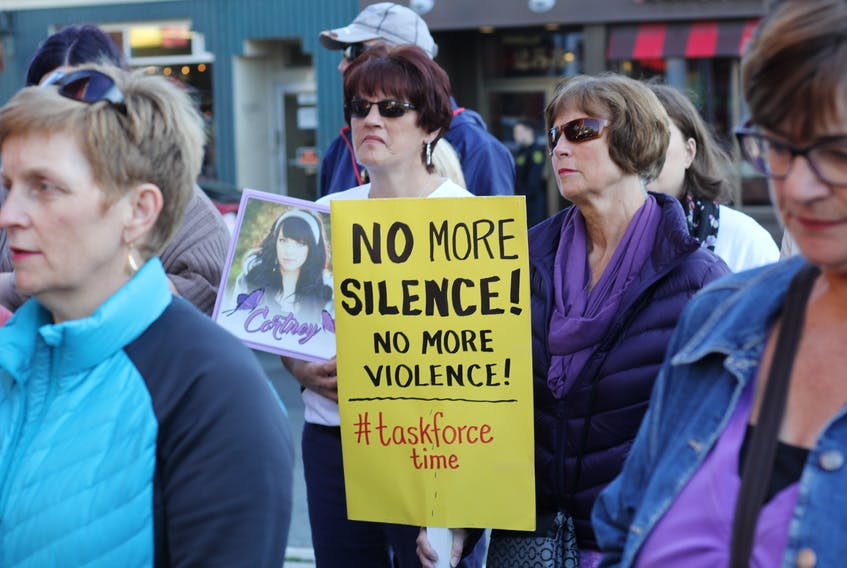 Family members of Cortney Lake, including her mom, Lisa Lake (holding photo), joined other family members of murdered women and girls for a rally in downtown St. John's Thursday afternoon. The group called for the government to implement a task force to address the issue of violence against women in this province.