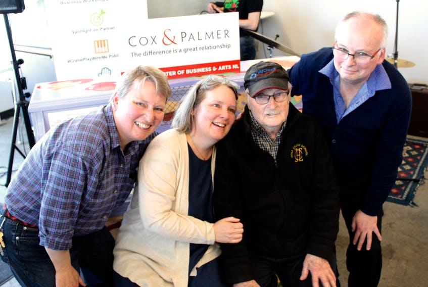 Linda, Laura, Cyril, and Stephen Fitzpatrick pose for photos in front of the province's newest Business and Arts NL public piano at the St. John's Farmers' Market on Freshwater Road.