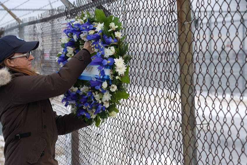 Lori Chynn of Deer Lake places flowers March 12, 2019 at St. John's International Airport as a memorial to her husband, John Pelley, who lost his life in the crash of Cougar Helicopters Flight 491 on March 12, 2009. Chynn flew to St. John's to take part in the anniversary events. - Joe Gibbons