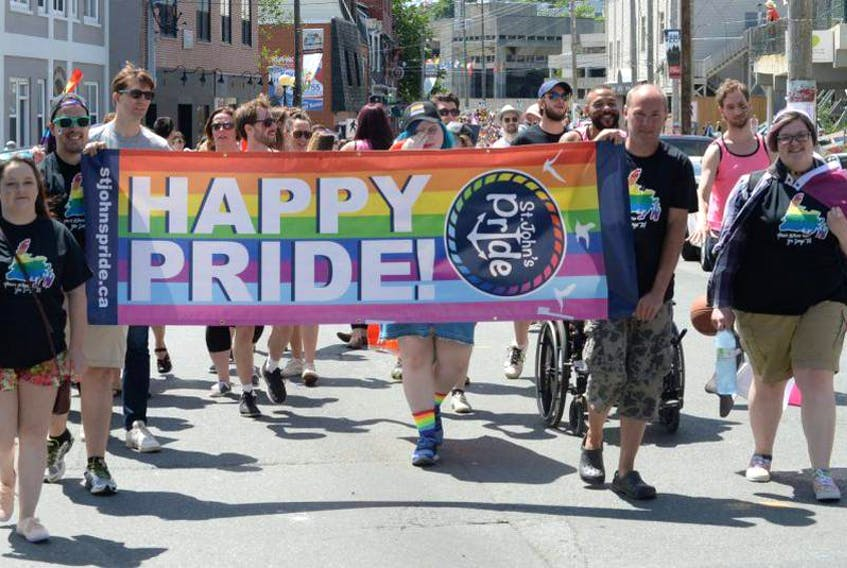 Participants walk in the St. John's Pride Parade in July 2017.
