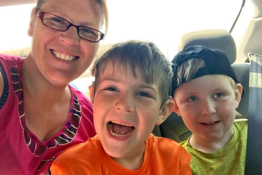 Kimberly Churchill with her sons Carter (centre) and Hunter.