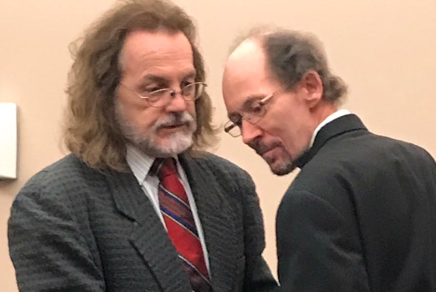 Kenneth Harrisson (right) speaks with his lawyer, Bob Buckingham, before leaving provincial court in St. John's after his trial wrapped up Monday morning.