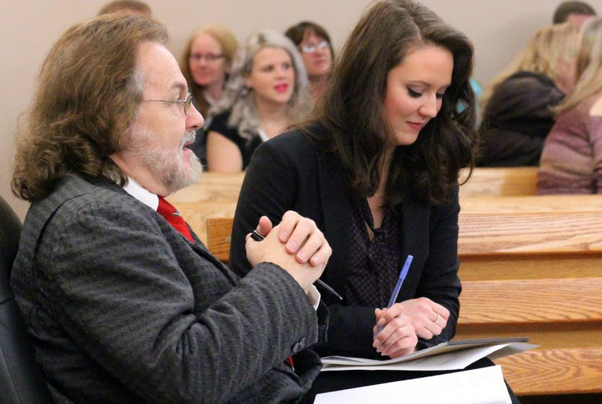 Defence lawyers Bob Buckingham and Brittany Whalen (foreground) wait for their client Steve Bragg's case to be called in provincial court in St. John's Thursday morning. Behind them sit family members and friends of Victoria Head, the 36-year-old woman Bragg is accused of murdering on Nov. 11.