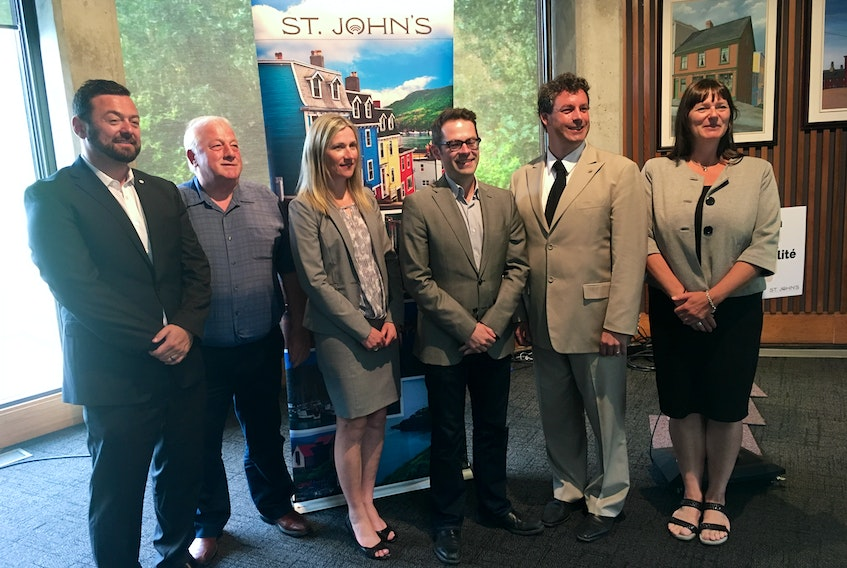 (From left) left to right: Coun. Jamie Korab, Coun. Wally Collins, Metrobus manager Judy Powell, Coun. Dave Lane, MP Nick Whalen, Deputy Mayor Sheilagh O'Leary were on hand for Monday's funding announcement which will lead to upgrades for the Metrobus service.