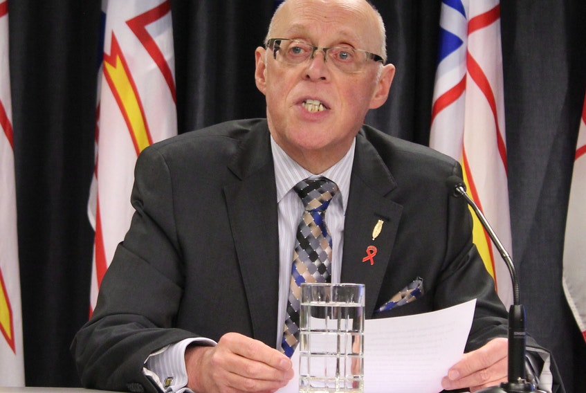 Health Minister John Haggie outlines the new health care legislation on Tuesday.