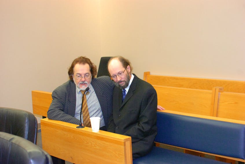 Kenneth Harrisson (right) speaks with his lawyer, Bob Buckingham, prior to the start of proceedings in Harrisson's trial at provincial court in St. John's Tuesday.