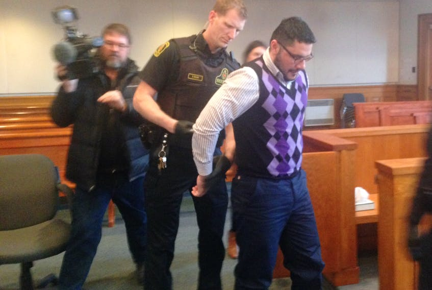 Former taxi driver Lulzim (Leon) Jakupaj is handcuffed and led out of the courtroom at Newfoundland and Labrador Supreme Court in St. John's Monday after being found guilty of two more counts of sexual assault against female passengers.