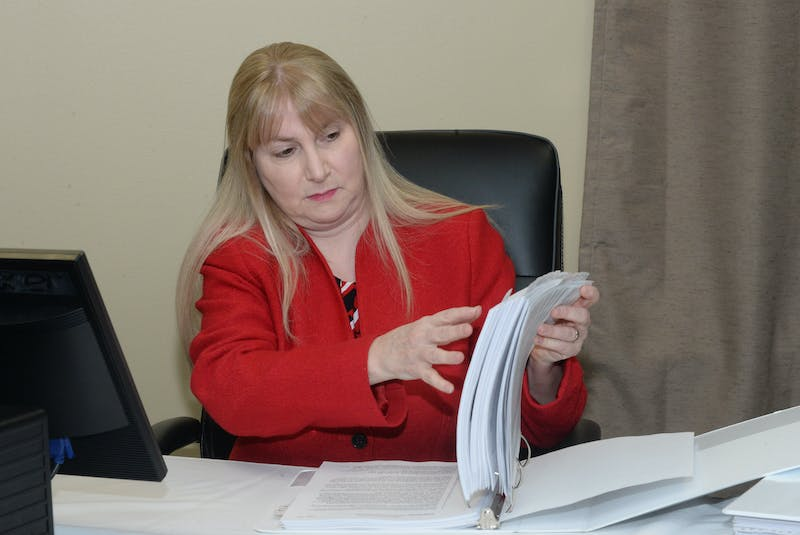 Newfoundland and Labrador Auditor General Julia Mullaley and former clerk of the Executive Council, goes over documents before her second day of testimony at the Muskrat Falls Inquiry in St. John's. - Joe Gibbons/SaltWire Network