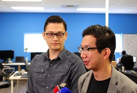 HeyOrca co-founders Joe Teo (right) and Sahand Seifi speak with reporters about Monday's announcement.