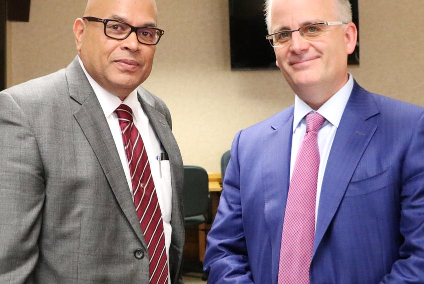 Lawyers Ernest Gittens (left) and Barry Mason represent the Atlantic Provinces Trial Lawyers Association at the insurance review public hearings being carried out by the Public Utilities Board (PUB).