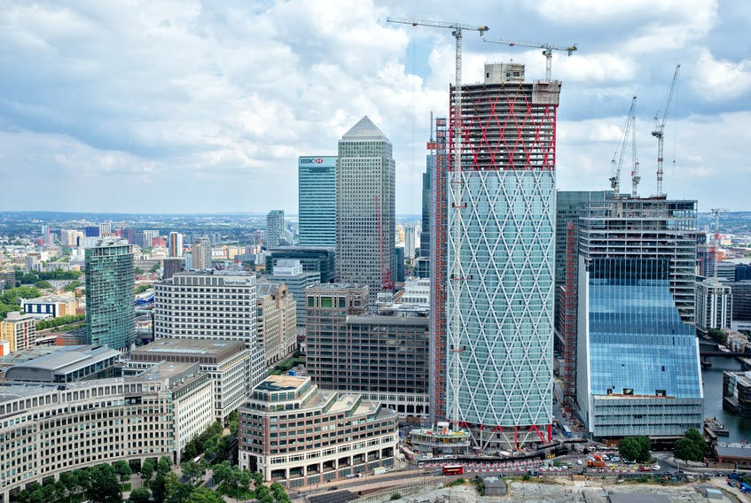 """The """"Newfoundland,"""" a residential building currently under construction at the western end of the massive Canary Wharf estate, close to the River Thames, in London, England, is set to open in December. — Newfoundland, Canary Wharf, photo"""