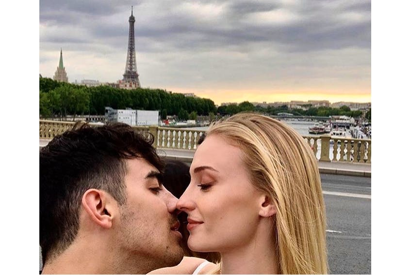 The Headroom Salon & Spa announced hairstylist Eryn Wall's return from the celebrity wedding in France with this photo to its Instagram feed, of newlyweds Joe Jonas and Sophie Turner in Paris.