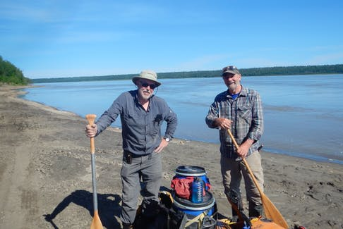 Herman Perry and Paul Snow take a break along the shores of the Mackenzie River.