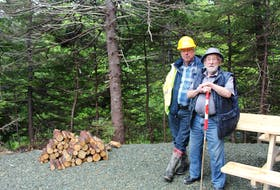 Dan Walker (left) and his father, Lloyd Walker, on family land that is being developed into the Waterford River Valley Campground in Mount Pearl.