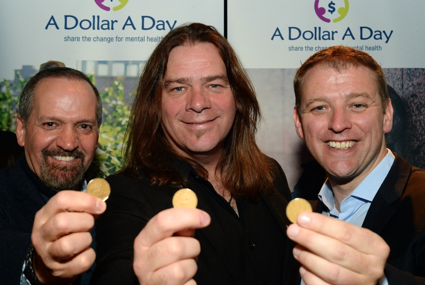 From left, businessman Brendan Paddick, musician Alan Doyle and Dr. Andrew Furey at the launch of their A Dollar A Day organization Tuesday at The Rooms in St. John's.