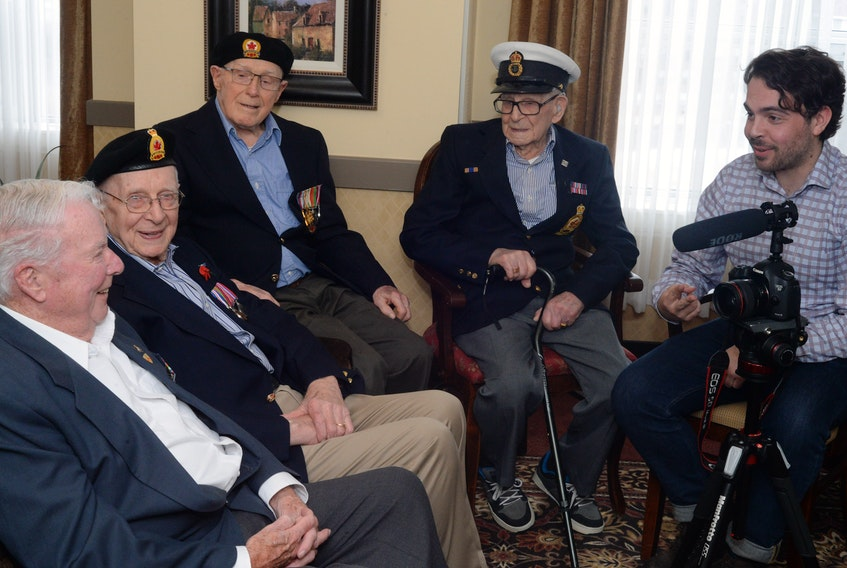 Eric Brunt (right), a 26-year-old filmmaker from British Columbia, speaks with Second World War veterans in St. John's Monday. (From left) are Joe Prim, 92, Merchant Navy (1943-1945); James Steele, 94, 59th Heavy Artillery Regiment (1943-1945); Elmo Baird, 99, Royal Airforce (1939-1945); and Rod Deon, 97, Canadian Navy onboard the HMCS Ottawa II and who also saw action on D-Day in the English Channel (1942-1945).
