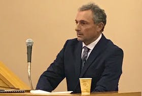 Dr. Nash Denic, a forensic pathologist who will soon take over as the province's chief medical examiner, prepares to testify at the murder trial of Allan Potter Tuesday. Denic performed an autopsy on Dale Porter in the days after his death.