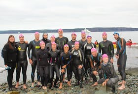 Sixteen swimmers braved The Tickle to raise money for mental health initiatives Saturday.