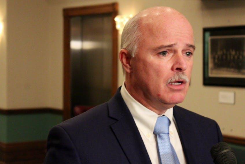 Finance Minister Tom Osborne speaks to reporters Tuesday.