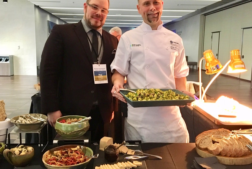 Centerplate general manager Rejean Roch (left) and executive chef Jeremy McKinnon display one of the many dishes that were provided at the St. John's Convention Centre Thursday at the launch of Centerplate being named SJCC's exclusive food and beverage provider.