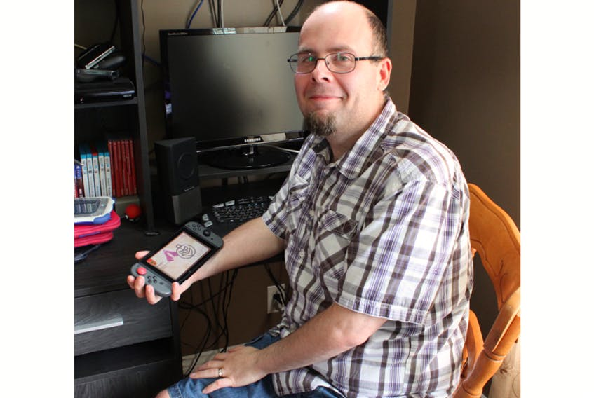 """Gordon Little is a game creator in Portugal Cove-St. Philip's. He released """"Spell Casting"""" as a computer game in 2014, and now it's coming out on Nintendo Switch. His daughter, Zoey, is the voice of one of the cats in the game."""
