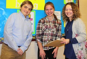 Students at Macdonald Drive Junior High in St. John's will get a lesson in an anti-cyberbullying message on Thursday as part of the WE Rise Above campaign the school is part of. Final preparations in the initiative are nearly complete, including this quick meeting of (from left) student council president Daniel Blackmore, leadership committee member Silvi Ivardi and guidance counsellor Christina Watton, staff adviser to the WE programs. The group discusses what will occur from 1:30-5:30 p.m. on Thursday.