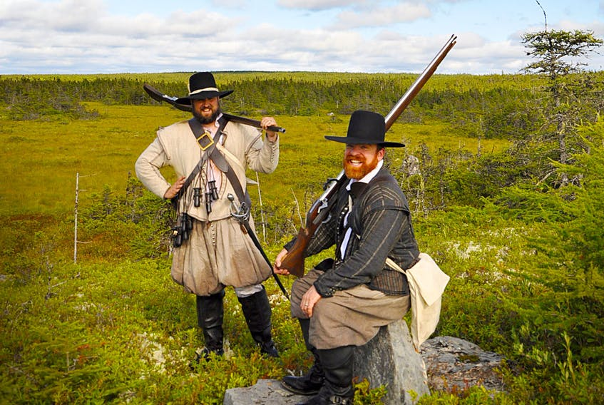 Chris Martin (left) and Chris Driedzic resting after crossing bogs all day north of Loo Pond, south of the New Harbour Barron Road. — Courtesy of Chris Martin