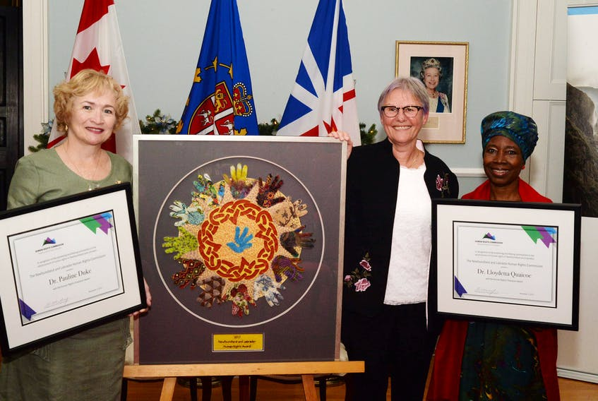 Pictured with their achievement awards following a ceremony at Government House Thursday for the 2017 Human Rights Awards are:  (from left) Dr. Pauline Duke, Susan Rose and Lloydetta Quaicoe. Rose was the winner of the award and Duke and Quaicoe were named human rights champions.