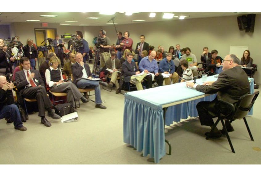 Reporters gather at Confederation Building for the release of the Cameron Report in 2009.