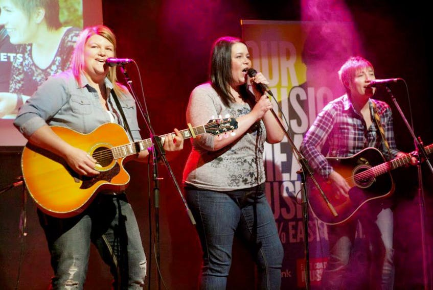 The Secrets on stage (from left) Karla Pilgrim, Terry Lynn Eddy and Renée Batten, are an acclaimed country music group, but over the next month, will be performing a pair of gospel shows.